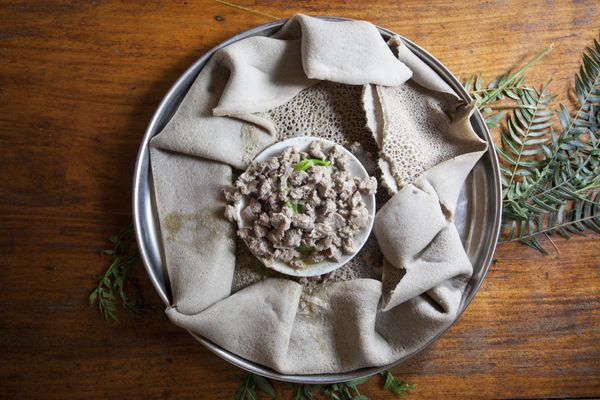 Injera is a national dish in Ethiopia. It's a spongy flatbread that's served with stews and salads. And, it's the best. If yo