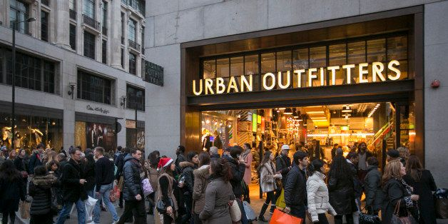 LONDON, ENGLAND - DECEMBER 14: Christmas shoppers walk outside Urban Outfitters on December 14, 2013 in London, England. As Christmas Day approaches, London's central shopping districts attempt to lure shoppers into stores with last minute deals in an effort to pull sales away from online outlets. (Photo by Dan Dennison/Getty Images)
