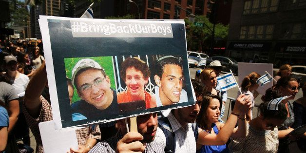 NEW YORK, NY - JUNE 16:  People gather for a vigil for the three missing Israeli teens outside of the Israeli Consulate on Ju