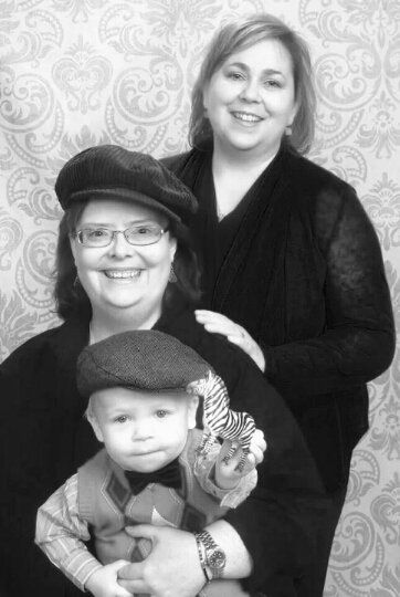 """""""Here is a photo of our family: Rev. Jeanne Loveless, Rev. Dr. Christy Newton and our son Clivie."""""""