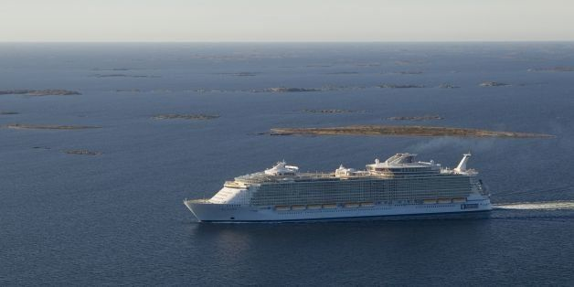 The MS Allure of the Seas, the world's largest passenger vessel, navigates away from a shipyard in Turku on October 29, 2010.