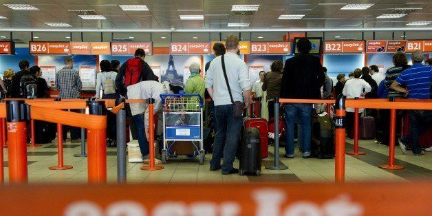 Passengers queue up at the Easyjet counter at Berlin's Schoenefeld airport on May 25, 2011, as air traffic is disturbed as ashes spewed from Iceland's Grimsvoetn volcano. Ash pouring from the Icelandic volcano reached northern Germany, forcing the closure of airports from Hamburg to Berlin, amid fears European air traffic could soon suffer further disruptions. The cloud is the second in barely a year from an Icelandic volcano to disrupt European air traffic. The airports will reopen by afternoon, German Transport Minister Peter Ramsauer said.   AFP PHOTO / JOHANNES EISELE (Photo credit should read JOHANNES EISELE/AFP/Getty Images)