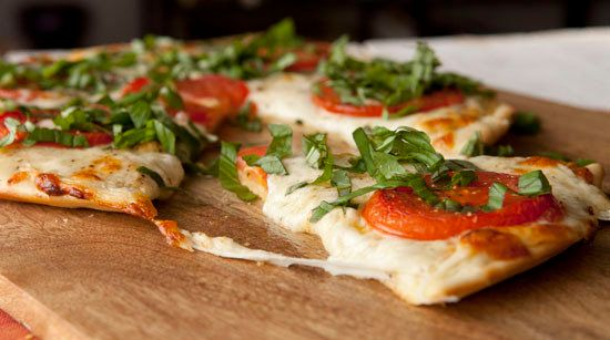 """<strong>Get the <a href=""""http://www.macheesmo.com/2013/12/white-pizza-sauce/"""" target=""""_blank"""">White Pizza</a> recipe from Mac"""