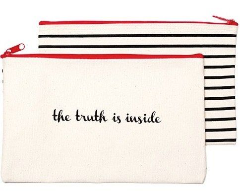 We love this kitschy canvas pouch for two main reasons. First, your essentials (lipstick, mascara, eyeliner and blush) fit pe
