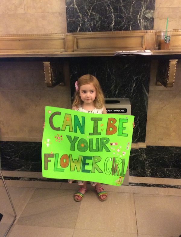 <strong>Annabelle held this sign inside City Hall, hoping that a pair of soon-to-be newlyweds would walk by and ask her to be