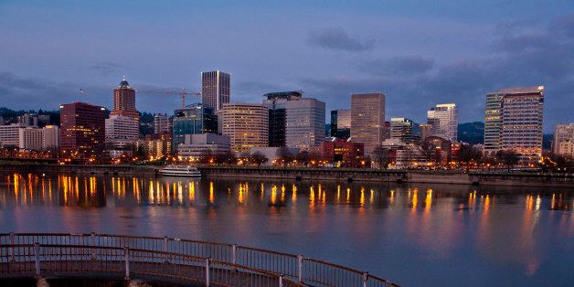 PORTLAND, OR - FEBRUARY 11:  The downtown skyline and an Eastbank Esplanade walkway are viewed in the early morning on Februa