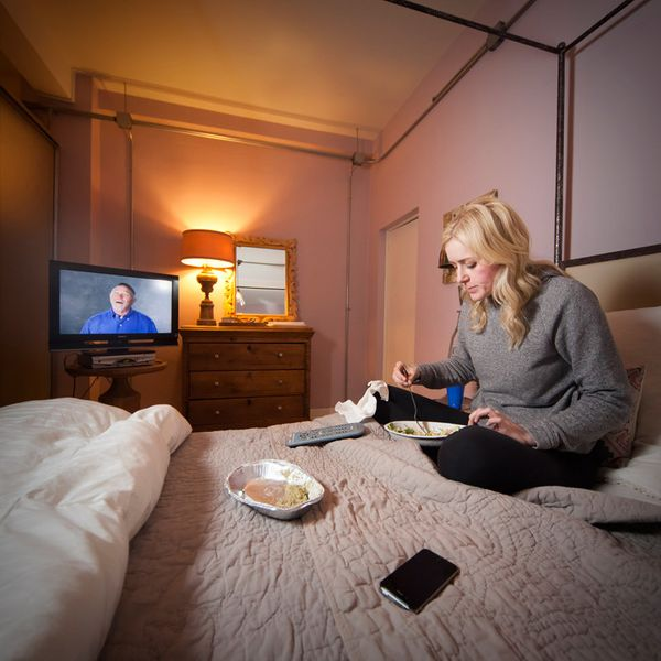 Jessie Zinke, a designer, has leftovers for dinner on her bed, while watching her favorite TV show. <br><strong>Age:</strong>
