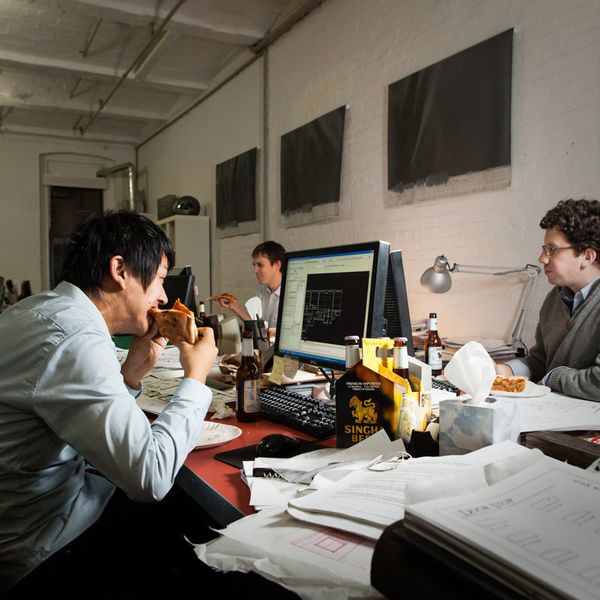 Yohan Kim, an architect, worked over time with his coworkers. They had pizza and beer on the desk.
