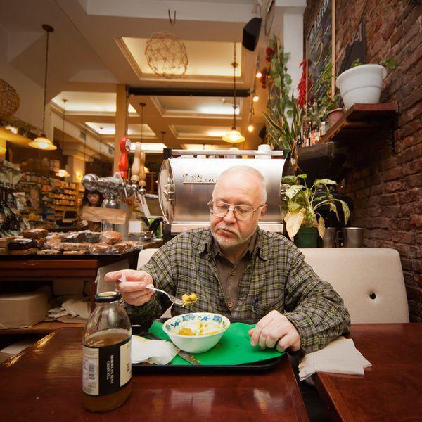 Richard Phillip Nelson, who works in several restaurants, eats dinner during his break at Earthmatters, an organic cafe. He i