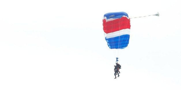 KENNEBUNKPORT, ME - JUNE 12:  Former U.S. President George H.W. Bush and Mike Elliott, US Army Sergeant 1st Class (ret), jump out of a helicopter and parachutes down to St. Anne's Episcopal Church on June 12, 2014 in Kennebunkport, Maine. The President is celebrating his 90th birthday today.   (Photo by Eric Shea/Getty Images)