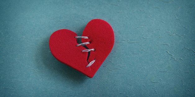 red heart  broken with threaded ...