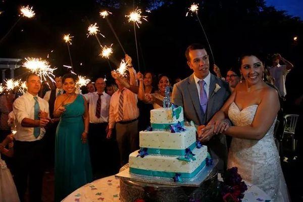 """My beautiful wife and I, sparkle cake cutting."" -- Kevin Szczecina"