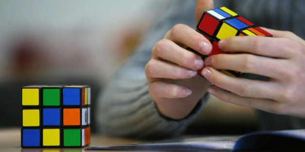 A seventh grade student of the 'Free Christian' school in Duesseldorf trys out the Rubik's Cube for the first time on November 9, 2010. Starting in January 2011 schools can decide to use the Rubik's Cube to develop their children's spatial thinking and imagination. AFP PHOTO / PATRIK STOLLARZ (Photo credit should read PATRIK STOLLARZ/AFP/Getty Images)