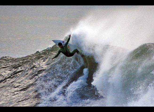 <em>Photo Credit: Ian Walsh Surfing Hurricane Bill, Newport, RI by Attribution-NonCommercial License</em>