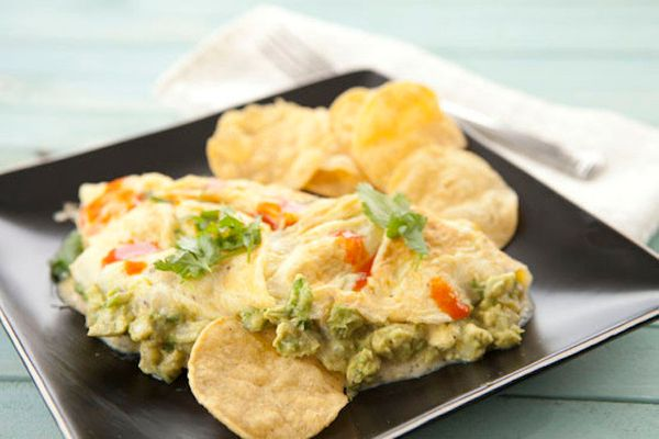 """<strong>Get the <a href=""""http://www.macheesmo.com/2013/01/guacamole-omelet/"""" target=""""_blank"""">Guacamole Omelet recipe</a> from"""