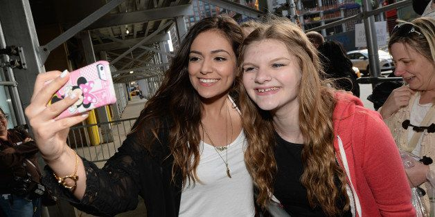 NEW YORK, NY - APRIL 23:  Bethany Mota (L) poses with a fan at Unleash YouTube Event with stars Michelle Phan, Rosanna Pansino And Bethany Mota on April 23, 2014 in New York City.  (Photo by Dimitrios Kambouris/Getty Images for YouTube)