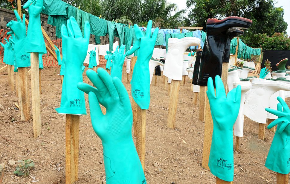 A view of gloves and boots used by medical staff, drying in the sun, at a center for victims of the Ebola virus in Gueckedou,