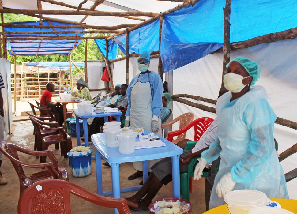 In this photo taken July 27, 2014, medical personnel are pictured inside a clinic taking care of Ebola patients in the Kenema