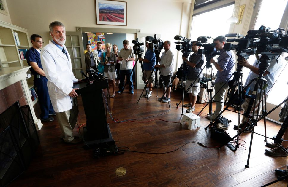 Dr. David McRay speaks about his friend and colleague Dr. Kent Brantly during a news conference on Monday, July 28, 2014, in