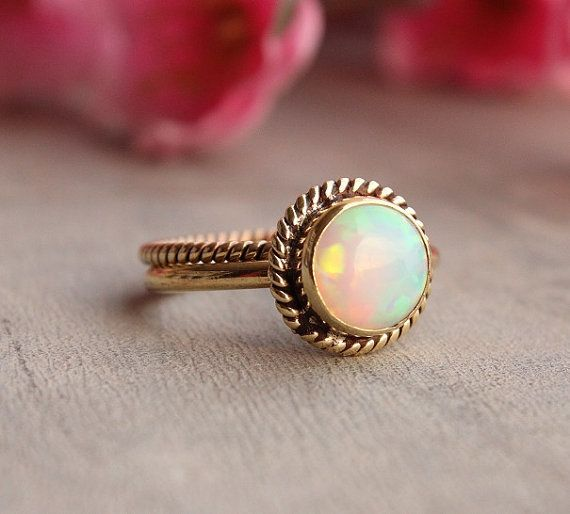 Ethiopian opal and 18k yellow gold, $885