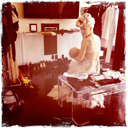 """During an album photo shoot in 2012, Pink shared a <a href=""""http://www.huffingtonpost.com/2012/06/21/pink-breastfeeding_n_161"""