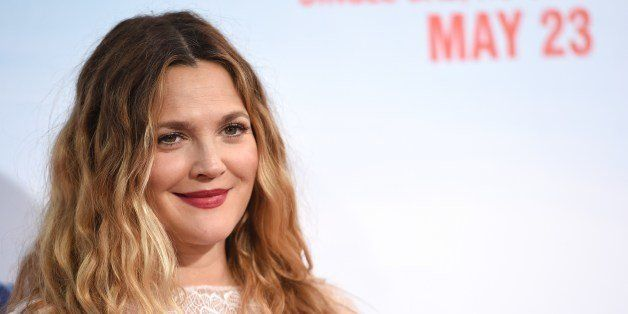 Actress Drew Barrymore arrives for the red carpet premiere of 'Blended,' May 21, 2014 at TCL Chinese Theatre in Hollywood, California.   AFP PHOTO / ROBYN BECK        (Photo credit should read ROBYN BECK/AFP/Getty Images)