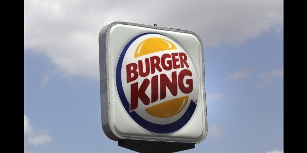 This Wednesday, June 20, 2012, photo shows a Burger King sign in Richardson, Texas. The world's No. 2 hamburger chain began trading as a public company again Wednesday under the ticker symbol ᅢ까タᅡワBKWᅢ까タᅡン for TKTKT a share. The Miami-based chain had last traded as a public company between 2006 and 2010, before it was purchased and taken private by investment firm 3G Capital. ( ( AP Photo/LM Otero)