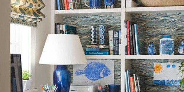 Twigs' Pheasant wallpaper energizes the broad expanse of shelves in the wife's home office of a house in Houston, Texas. Roman shades are Jasper's Indian ...