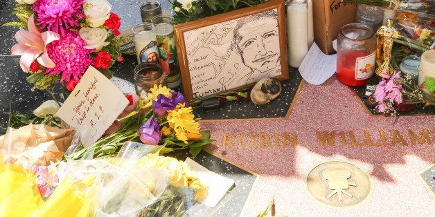 HOLLYWOOD, CA - AUGUST 12:  Flowers are placed on the Hollywood Walk of Fame Star and the hand and footprint in memory of actor Robin Williams on August 12, 2014 in Hollywood, California.  (Photo by Paul Archuleta/FilmMagic)