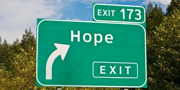 Highway sign illustrating the concept of 'Hope is just around the corner,' or 'this way for Hope'