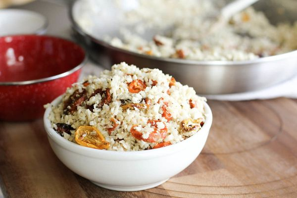 There's just so much you can eat atop your cauliflower rice. We say mix in some heirloom tomatoes and get a little creamy wit