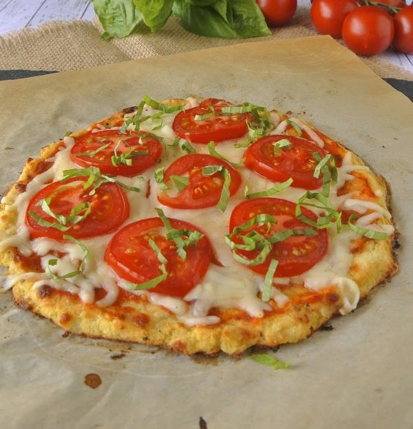 You might be skeptical about eating pizza crust made from cauliflower, but listen here: The substitution lets pizza's true st