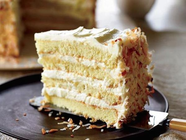 """<strong>Get the <a href=""""http://www.huffingtonpost.com/2011/10/27/towering-coconut-layer-ca_n_1059533.html"""" target=""""_blank"""">T"""