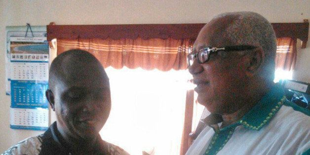 In this photo taken on Sunday, July 13, 2014,  Dr. Sheik Humarr Khan, left, talks with former Sierra Leone's Minister of Finance John Oponjo Benjamin at an Ebola center in Kenema, Sierra Leone. Dr. Sheik Humarr Khan a leading doctor died from ebola, officials said, as a major regional airline announced it was suspending flights to the cities hardest hit by an outbreak that has killed more than 600 people. Dr. Sheik Humarr Khan, who was praised as a national hero for treating the disease in Sierra Leone, was confirmed dead by health ministry officials there. He had been hospitalized in quarantine. (AP Photo)