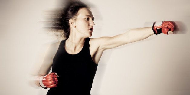 beautiful girl with boxing...