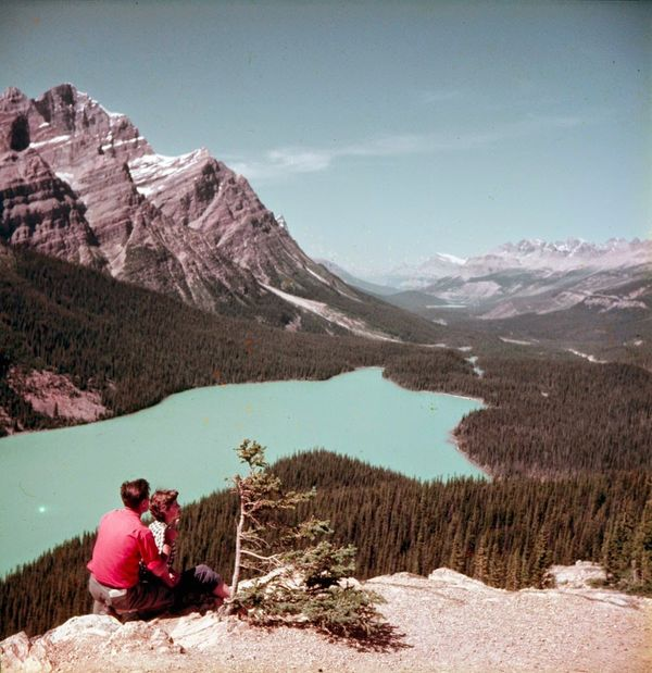 "Man and woman at Banff-Jasper Highway looking down on the Peyto Valley.  <a href=""http://collectionscanada.gc.ca/pam_archives"