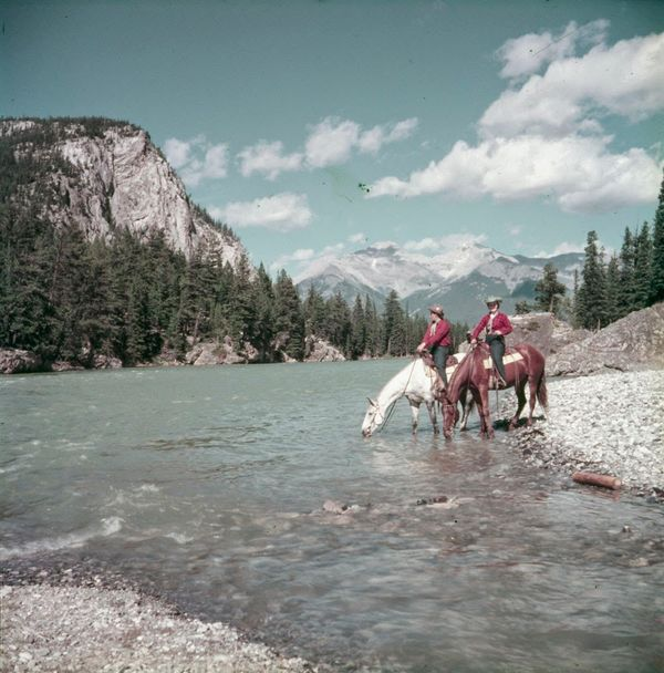 "Riders pause on the banks of the Bow River, 1953.  <a href=""http://collectionscanada.gc.ca/pam_archives/index.php?fuseaction="