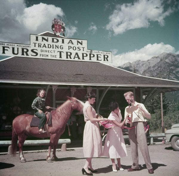 "One man, two women and a young girl on horseback at an Indian Trading Post, Banff, Alberta.  <a href=""http://collectionscanad"