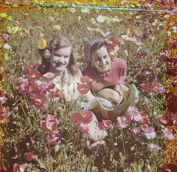 "Two women in a field of poppies near Lake Louise.  <a href=""http://collectionscanada.gc.ca/pam_archives/index.php?fuseaction="