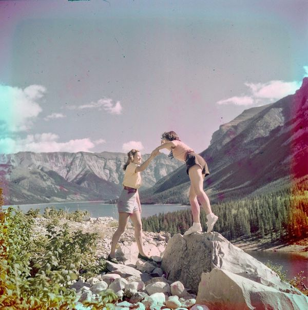 "Two women rock climbing near Moraine Lake.  <a href=""http://collectionscanada.gc.ca/pam_archives/index.php?fuseaction=genitem"