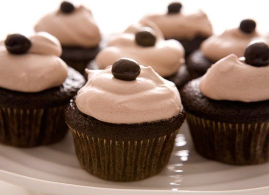 Coffee brings out the flavor of chocolate in this recipe for cupcakes. Sour cream makes them extra moist and tender. Top the