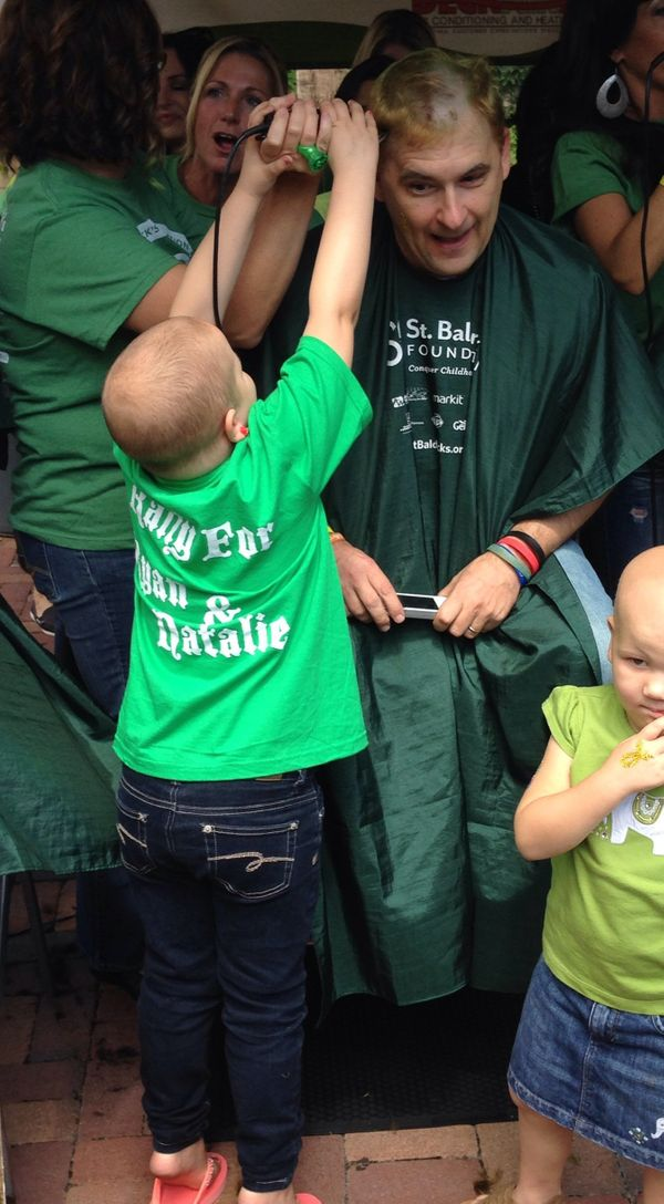 This is my daughter Logan, shaving her pediatric oncologist's head at a a St. Baldricks event. To me it represents the love,