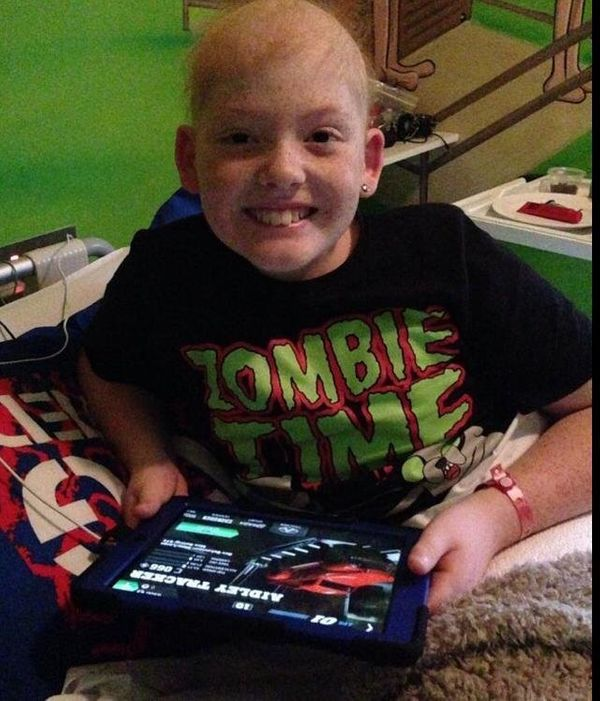 Our son Angus, age 11. He was diagnosed with ewing's sarcoma in June 2014. Three months of intensive chemo down, major surger