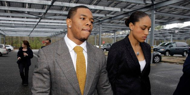 "FILE - In this May 1, 2014, file photo, Baltimore Ravens football player  Ray Rice holds hands with his wife, Janay Palmer, as they arrive at Atlantic County Criminal Courthouse in Mays Landing, N.J. Banter by two ""Fox & Friends"" hosts about video showing Rice hitting his then future wife is under fire. The hosts, Brian Kilmeade and Steve Doocey, made their on-air comments Monday, Sept. 8, 2014, while discussing newly released elevator video showing Rice hitting Janay Palmer in February. (AP Photo/Mel Evans, File)"