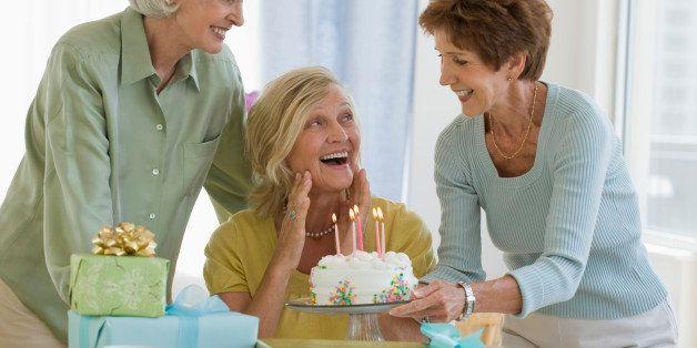 Senior women celebrating friend's birthday