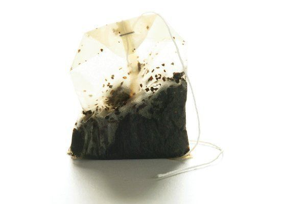 Use your used tea bags (cooled) to clean wood surfaces like cabinets and floors and use the cooled tea as a polish -- the tea