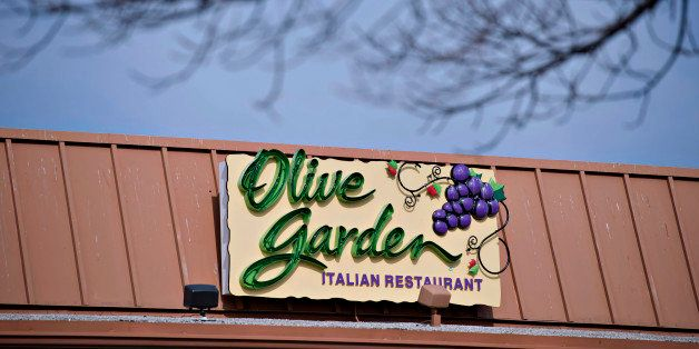 Darden Restaurants Inc. Olive Garden signage is displayed outside of a location in Peoria, Illinois, U.S., on Tuesday, March 18, 2014. Darden Restaurants Inc. is scheduled to release earnings figures on March 21. Photographer: Daniel Acker/Bloomberg via Getty Images