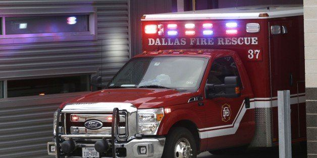 An ambulance pulls into the Dallas Fire-Rescue station 37 in Dallas, Wednesday, Oct. 1, 2014.  Three EMT's from this location