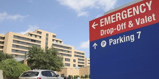A vehicle drives up the driveway to the Texas Health Presbyterian Hospital in Dallas, Tuesday, Sept. 30, 2014. A patient in the hospital is being teated for Ebola.  (AP Photo/LM Otero)