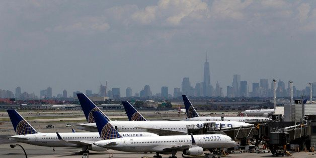 United Airlines jets are seen at the gate at Newark Liberty International Airport, Tuesday, July 22, 2014, in Newark, N.J. In a sign of increased caution about flying near combat zones, U.S. and European airlines halted flights to Israel Tuesday after a rocket landed near Tel Aviv's Ben Gurion Airport. Delta Air Lines and United Airlines suspended service between the U.S. and Israel indefinitely. The actions come days after a Malaysia Airlines jet was shot down over eastern Ukraine with 298 people on board. (AP Photo/Julio Cortez)